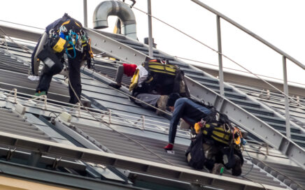 Roofers at work on the roof in winter