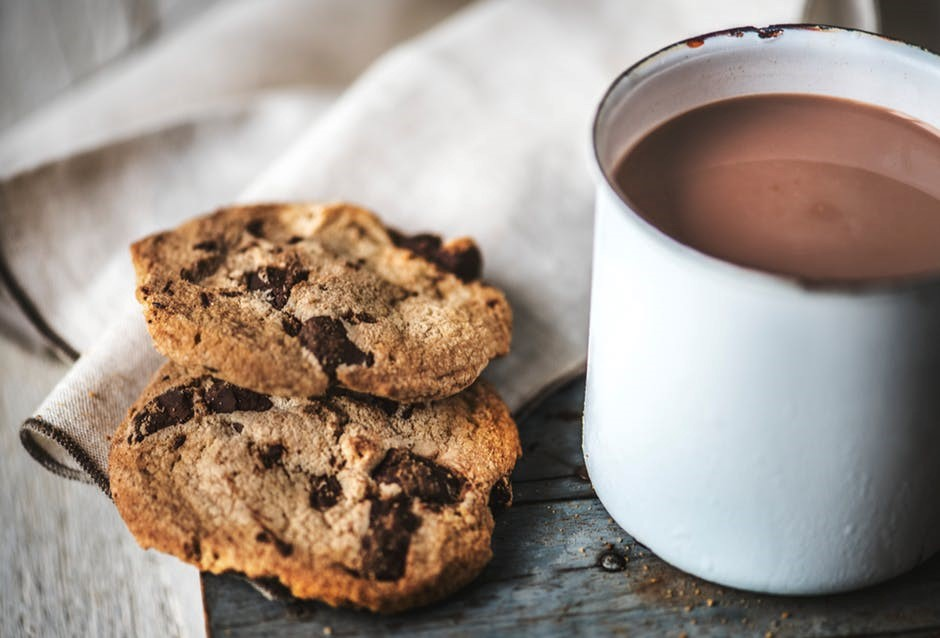 warm cup of hot cocoa and chocolate chip cookies