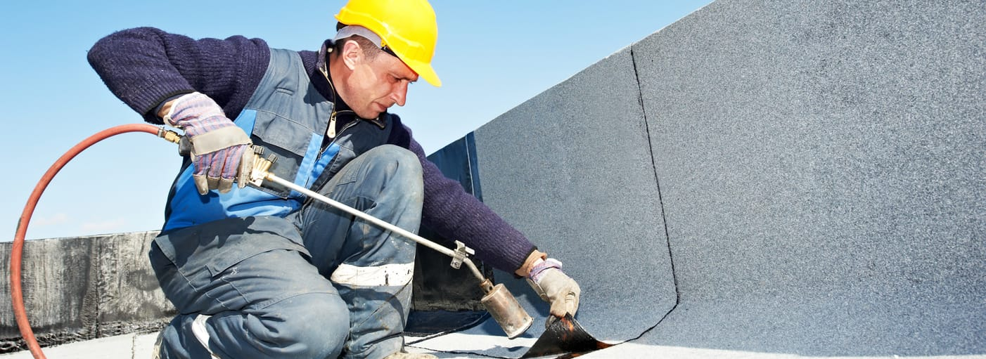 commercial roofing specialist fixing roof